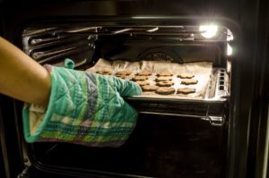 Cookies Being placed into a heated range oven